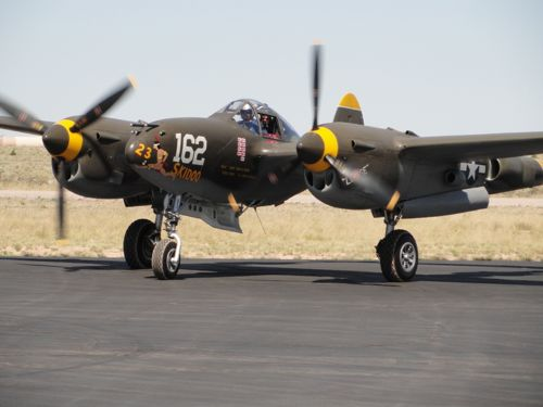 The P-38 taxis in after another successful mission